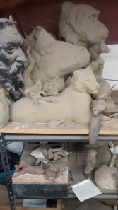 Maquettes from old projects gathering dust as they oversee our work.